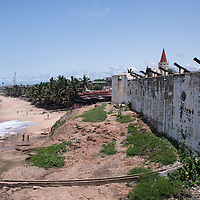 Rusting cannons aimed towards the Atlantic Ocean line the ramparts of the Cape Coast Castle, a UNESCO World Heritage Site located along the Gold Coast of Ghana.