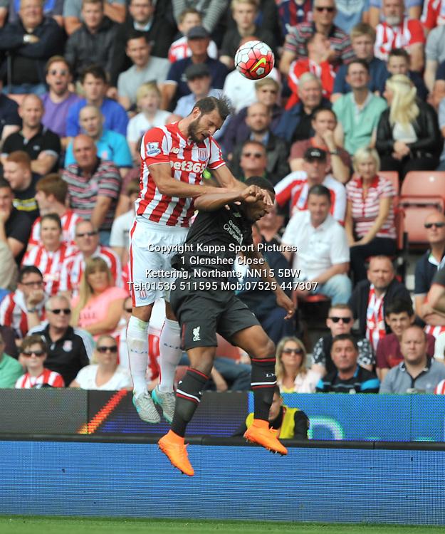 STOKES ERIK PIETERS HOLDS OF LIVERPOOL JORDAN IBE, Stoke City v Liverpool, Premiership, Britannia Stadium Sunday 9th August 2015