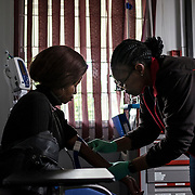 Siphile Madlola, 22 yo, is HIV negative. She is having a blood sample withdrawn at the CAPRISA clinic in the rural area of Vulindlela in KwaZulu Nataln during a safety visit, as part of a research study. She decided to join one of the research programmes led by CAPRISA in Vulindlela after having unprotected sex with a man she did not trust. Vulindlela, South Africa. 7 November 2017. © Miora Rajaonary / Wall Street Journal