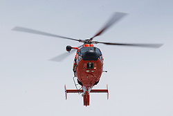 SAN FRANCISCO, CA - MAY 20: A United States Coast Guard Eurocopter MH-65C Dolphin flies over AT&T Park after the national anthem before the game between the San Francisco Giants and the Colorado Rockies on May 20, 2018 in San Francisco, California. The San Francisco Giants defeated the Colorado Rockies 9-5. (Photo by Jason O. Watson/Getty Images) *** Local Caption ***