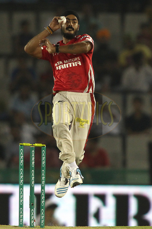 Anureet Singh of the Kings XI Punjab sends down a delivery during match 5 of the Oppo Champions League Twenty20 between the Kings XI Punjab and the Barbados Tridents held at the Punjab Cricket Association Stadium, Mohali, India on the 20th September 2014<br /> <br /> Photo by:  Shaun Roy / Sportzpics/ CLT20<br /> <br /> <br /> Image use is subject to the terms and conditions as laid out by the BCCI/ CLT20.  The terms and conditions can be downloaded here:<br /> <br /> http://sportzpics.photoshelter.com/gallery/CLT20-Image-Terms-and-Conditions-2014/G0000IfNJn535VPU/C0000QhhKadWcjYs