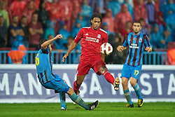 TRABZON, TURKEY - Thursday, August 26, 2010: Liverpool's Glen Johnson and Trabzonspor's Egemen Korkmaz during the UEFA Europa League Play-Off 2nd Leg match at the Huseyin Avni Aker Stadium. (Pic by: David Rawcliffe/Propaganda)