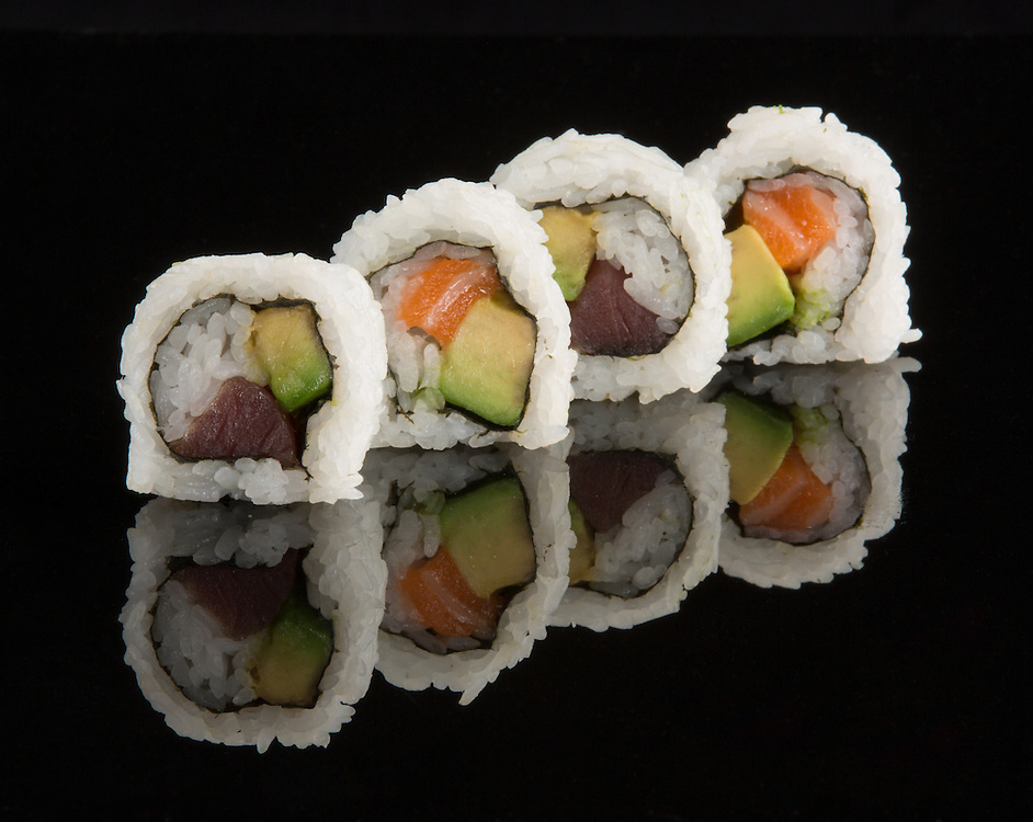 Sushi.  Salmon, Tuna and avocado roll.