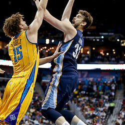 Mar 22, 2013; New Orleans, LA, USA; Memphis Grizzlies center Marc Gasol (33) shoots over New Orleans Hornets center Robin Lopez (15) during the second half of a game at the New Orleans Arena. The Hornets defeated the Grizzlies 90-83.  Mandatory Credit: Derick E. Hingle-USA TODAY Sports