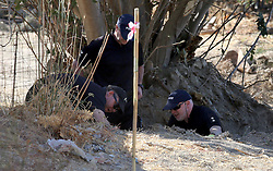 Detective Inspector Jon Cousins (right) of South Yorkshire Police in Kos, Greece, as officers from South Yorkshire Police continue excavations in relation to the missing toddler Ben Needham.