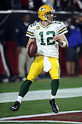 Green Bay Packers quarterback Aaron Rodgers (12) throws a late fourth quarter pass from his own end zone on third down with 20 yards to go for a first down during the NFL NFC Divisional round playoff football game against the Arizona Cardinals on Saturday, Jan. 16, 2016 in Glendale, Ariz. The Cardinals won the game in overtime 26-20. (©Paul Anthony Spinelli)