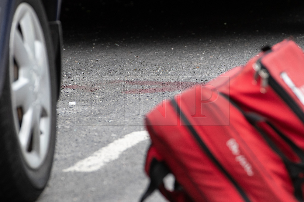 © Licensed to London News Pictures . 13/06/2018. Manchester , UK. Blood in the road at the scene on Birch Street , Ashton-Under-Lyne where a man was critically hurt in a shooting , this afternoon . Photo credit : Joel Goodman/LNP