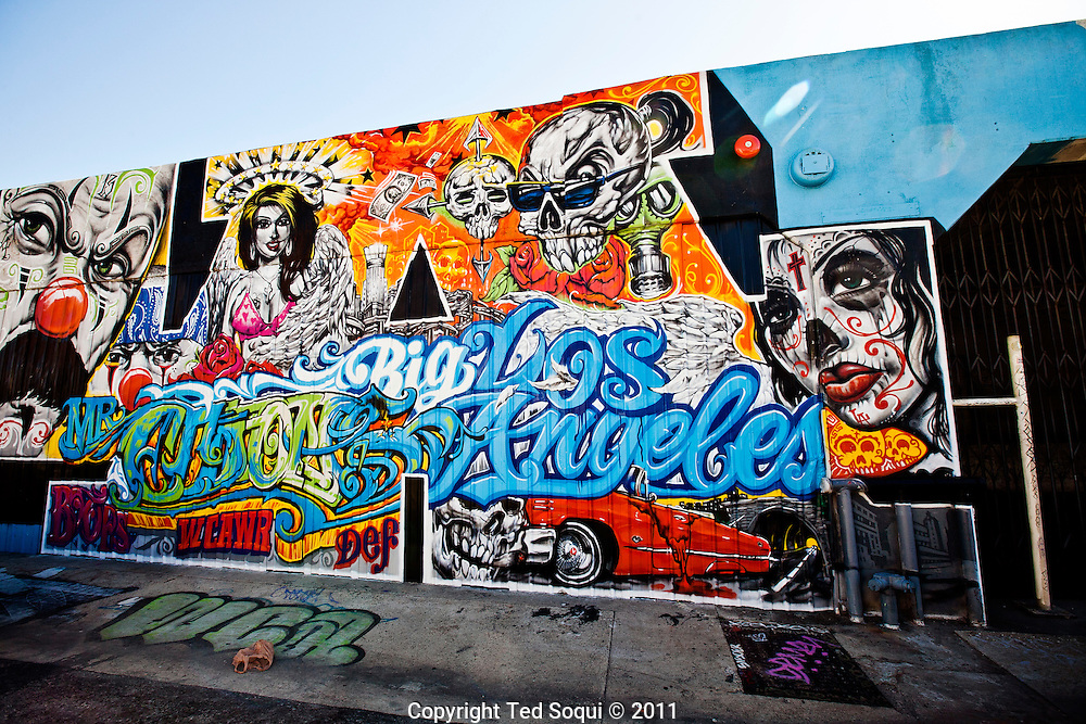 Street art in Los Angeles..L.A. has become the new ground zero for avant-guard and cutting edge street and graffiti. Artist from around the world now come to L.A. to post their work..Street art by Mr. Cartoon in the arts district of L.A.