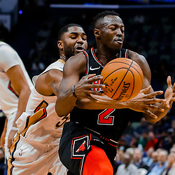 Jan 22, 2018; New Orleans, LA, USA; New Orleans Pelicans guard E'Twaun Moore (55) knocks away the ball from Chicago Bulls guard Jerian Grant (2) during the first quarter at  the Smoothie King Center. Mandatory Credit: Derick E. Hingle-USA TODAY Sports