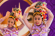 19 APRIl 2014 - BANGKOK, THAILAND: Girls perform a traditional Thai dance during a performance at the Rattanakosin Festival in Bangkok. Rattanakosin is the name of the man made island that is the heart of the old city. Bangkok was formally founded as the capital of Siam (now Thailand) on 21 April 1782 by King Rama I, founder of the Chakri Dynasty. Bhumibol Adulyadej, the current King of Thailand, is Rama IX, the ninth King of the Chakri Dynasty. The Thai Ministry of Culture organized the Rattanakosin Festival on Sanam Luang, the royal parade ground in the heart of the old part of Bangkok, to celebrate the city's 232nd anniversary.    PHOTO BY JACK KURTZ