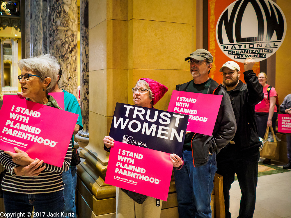 04 MAY 2017 - ST. PAUL, MN: Women and men line the hallways of the Minnesota Capitol and chant pro-choice slogans. About 50 people came to a protest to urge Minnesota State Senators to vote against two bills supported by the Republican party that would restrict access to women's health care in Minnesota. The protest was organized by  NARAL Pro-Choice Minnesota, NCJW Minnesota, and Planned Parenthood Minnesota. The Senate passed the bills but Minnesota's Democratic governor is expected to veto the legislation when it reaches his desk.     PHOTO BY JACK KURTZ