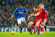 Oviemuno Ejaria (#10) of Rangers FC takes on Andy Considine (#4) of Aberdeen FC during the Ladbrokes Scottish Premiership match between Rangers and Aberdeen at Ibrox, Glasgow, Scotland on 5 December 2018.