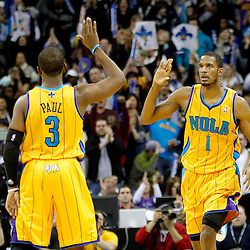 January 22, 2011; New Orleans, LA, USA; New Orleans Hornets small forward Trevor Ariza (1) celebrates with point guard Chris Paul (3) after hitting a three point basket against the San Antonio Spurs during the third quarter at the New Orleans Arena. The Hornets defeated the Spurs 96-72.  Mandatory Credit: Derick E. Hingle