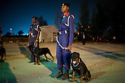 Nigerian riot police k-9 officers stand guard with  Rottweilers outside the Dome concert hall for the July 11, 2008 3rd annual THISDAY music and fashion festival in Abuja, Nigeria. The annual festival is designed to raise awareness of African issues while promoting positive images of Africa using music, fashion and culture in a series of concerts and events in Nigeria, the United States and the United Kingdom. .