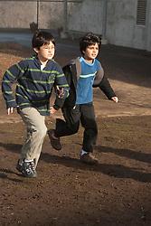 United States, Washington, Bellevue, boys running in playground at school