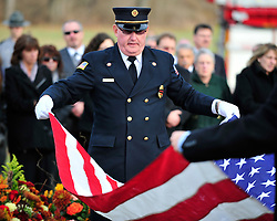 "Fire Commissioner Grant Grim folds the American Flag that will be presented to Ashmar's family. Funeral services with for Upper Macungie Township Fire Marshal Samir ""Sam"" Ashmar, 51 were held on November 25th, 2014, in Allentown, Pa. Ashmar died on November 20th in the line of duty following an emergency call. (Chris Post 