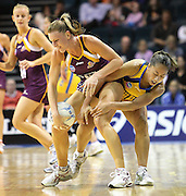 Keirra Trompf and Francis Solia compete for the ball. ANZ Netball Championship. Round 3 - Queensland Firebirds v Central Pulse. Played at Brisbane Convention Centre. Firebirds (56) defeated the Pulse (28).  Photo: Warren Keir (SMP/Photosport NZ).<br /> <br /> Use information: This image is intended for Editorial use only (e.g. news or commentary, print or electronic). Any commercial or promotional use requires additional clearance.