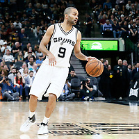 04 April 2017: San Antonio Spurs guard Tony Parker (9) dribbles during the San Antonio Spurs 95-89 OT victory over the Memphis Grizzlies, at the AT&T Center, San Antonio, Texas, USA.
