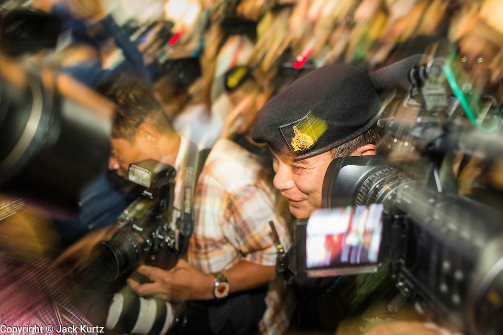 27 MAY 2014 - BANGKOK, THAILAND: A Thai army officer comes into the Foreign Correspondents' Club of Thailand to arrest Chaturon Chaisang. Chaturon, a former Deputy Prime Minister and Education Minister and a senior member of the Pheu Thai Party (the party of the elected civilian government) was arrested by military authorities in Bangkok while he was talking to reporters at the Foreign Correspondents' Club of Thailand. A squad of soldiers came into the packed FCCT dining room, confronted Chaturon and led him to a waiting van.     PHOTO BY JACK KURTZ