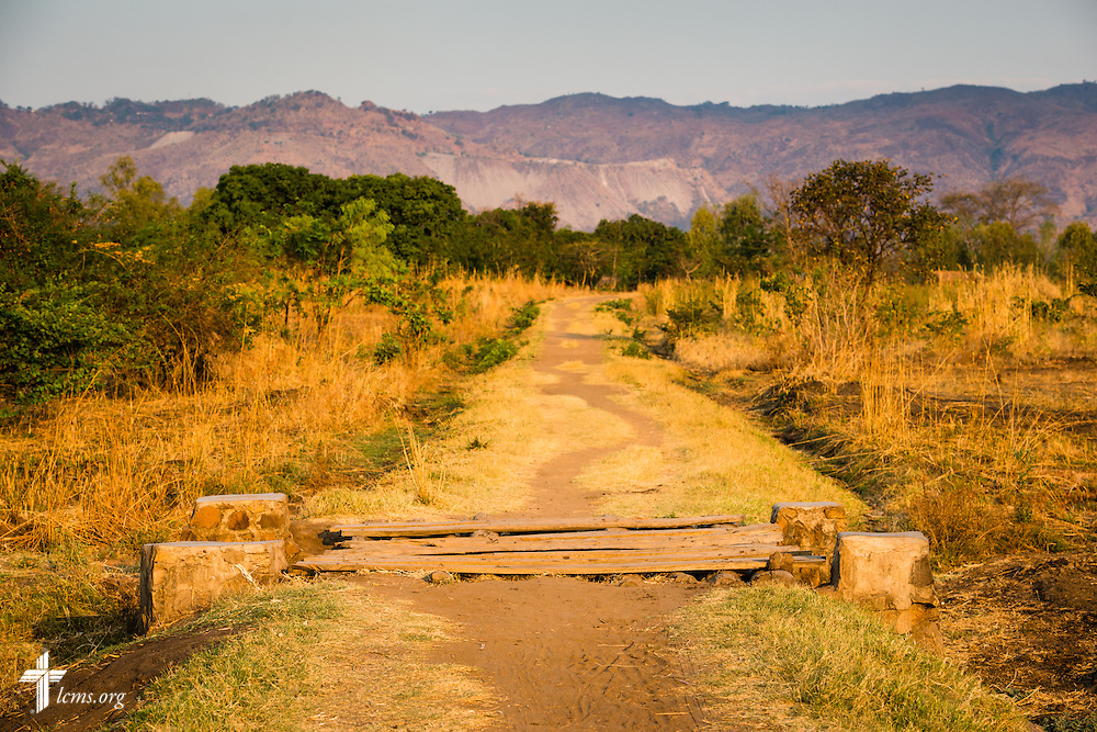 A wood plank bridge leads to a winding roadway on Sunday, Sept. 27, 2015, in Chingale, Malawi. LCMS Communications/Erik M. Lunsford
