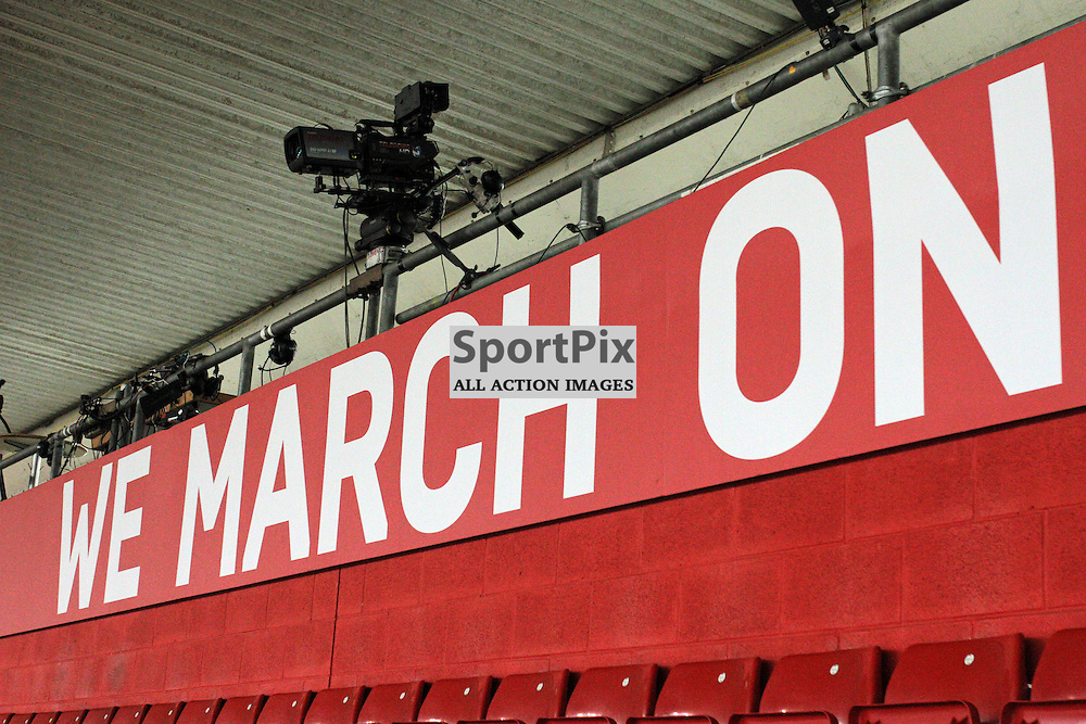 "Southampton FC's Slogan ""We March On"" is shown on a board at the back of the stadium before the game vs Fc Midtjylland on Thursday the 20th August 2015."