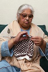 South Asian lady knitting,