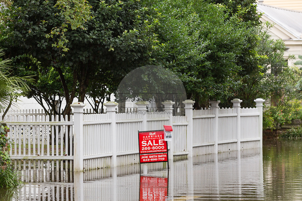 A sale sign in front of a home in floodwater as severe flooding continued for the second day in the historic district as Hurricane Joaquin brings heavy rain, flooding and strong winds as it passes offshore October 4, 2015 in Charleston, South Carolina.