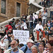 Man with sign giving away Free Hugs at the Spanish Steps, Rome, Italy