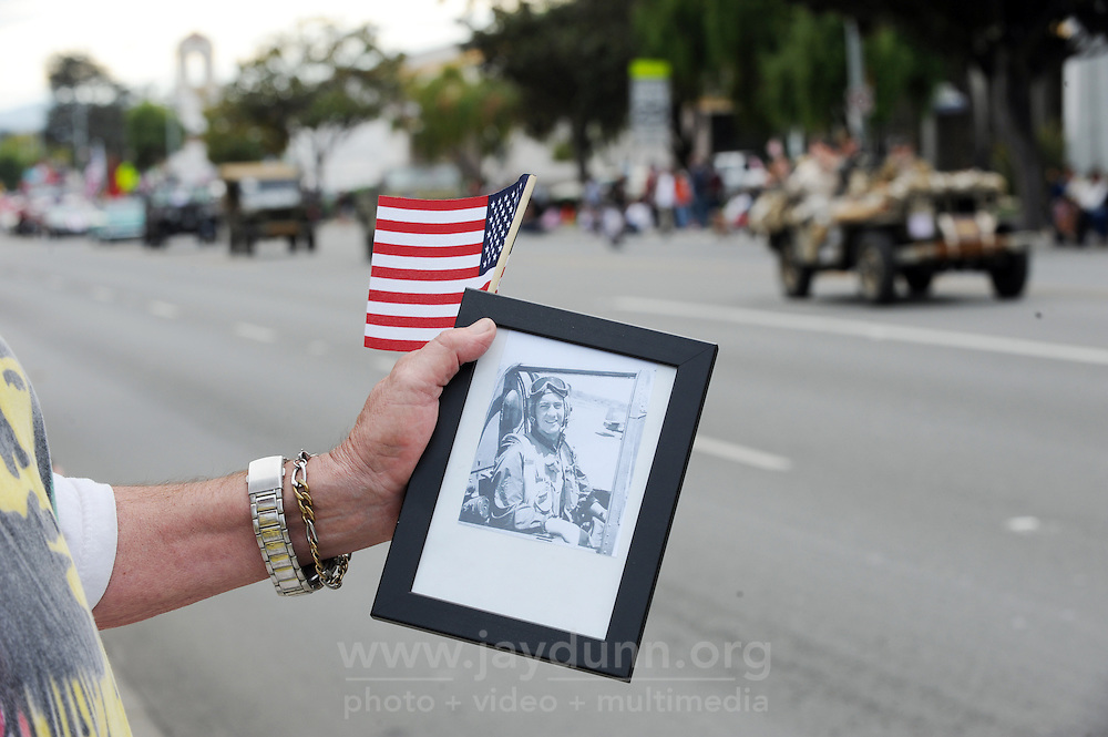 John Goodwin Jr. brought a photograph of his father, John Goodwin, to Monday's 3rd Annual Monterey County Veterans Parade in Salinas. John Goodwin flew 44 combat missions in the Pacific theater during World War II, and was awarded a Distinguished Flying Cross.