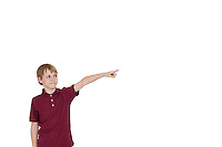 Boy pointing at copy space on white background