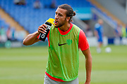 Portsmouth defender Christian Burgess (6) takes a drink of water while warming up during the EFL Sky Bet League 1 match between Shrewsbury Town and Portsmouth at Greenhous Meadow, Shrewsbury, England on 3 August 2019.