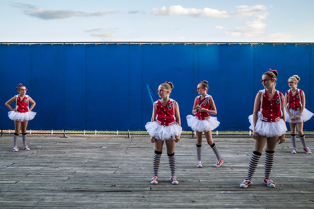 Girls prepare to perform a dance routine before the coronation of the Hamilton County Fair Queen on Wednesday, July 24, 2013 in Webster City, IA.
