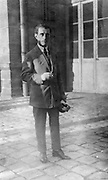 Maurice Ravel, 1875-1937, French composer, pianist and conductor in the courtyard of the Conservatoire de Musique, Paris, France, photograph, 1920, by unknown photographer. Copyright © Collection Particuliere Tropmi / Manuel Cohen