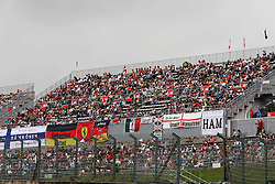 Fans in the grandstand.<br /> 08.10.2016. Formula 1 World Championship, Rd 17, Japanese Grand Prix, Suzuka, Japan, Qualifying Day.<br /> Copyright: Moy / XPB Images / action press
