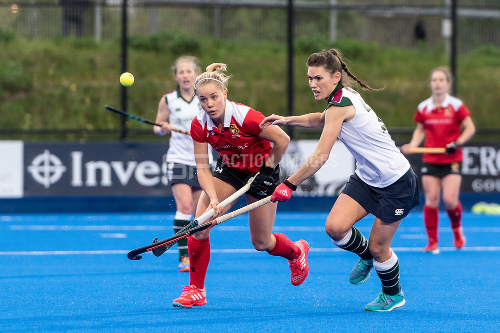 Holcombe's Heather McEwab challenges Holly Payne for the ball. Holcombe v Surbiton - Investec Women's Hockey League Final, Lee Valley Hockey & Tennis Centre, London, UK on 29 April 2018. Photo: Simon Parker