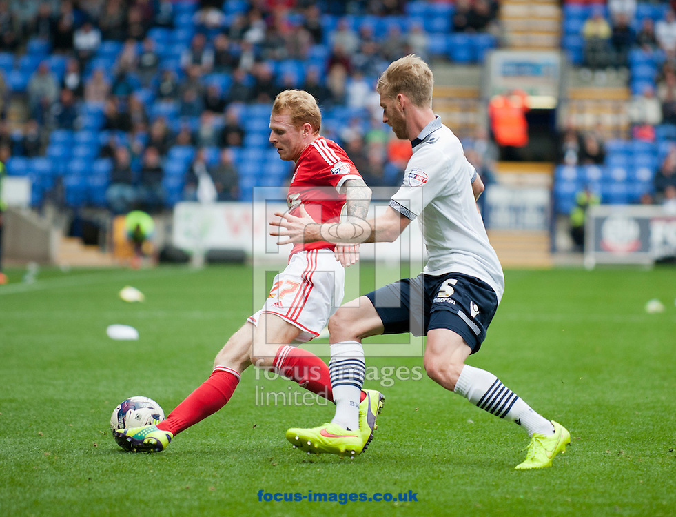 Tim Ream of Bolton Wanderers closes down Chris Burke of Nottingham Forest during the Sky Bet Championship match at the Macron Stadium, Bolton<br /> Picture by Russell Hart/Focus Images Ltd 07791 688 420<br /> 16/08/2014
