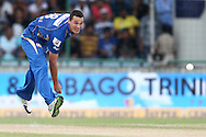 Nathan Coulter-Nile of Mumbai Indians sends down a delivery during match 19 of the Karbonn Smart Champions League T20 between the Perth Scorchers and the Mumbai Indians held at the Feroz Shah Kotla Stadium, Delhi on the 2nd October 2013<br /> <br /> <br /> Photo by Shaun Roy-CLT20-SPORTZPICS <br /> <br /> Use of this image is subject to the terms and conditions as outlined by the CLT20. These terms can be found by following this link:<br /> <br /> http://sportzpics.photoshelter.com/image/I0000NmDchxxGVv4