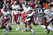 LITTLE ROCK, ARKANSAS - NOVEMBER 23:  Damian Williams #14 of the Mississippi State Bulldogs runs for the game winning touchdown in overtime against the Arkansas Razorbacks at War Memorial Stadium on November 23, 2013 in Little Rock, Arkansas.  The Bulldogs defeated the Razorbacks 24-17.  (Photo by Wesley Hitt/Getty Images) *** Local Caption *** Damian Williams