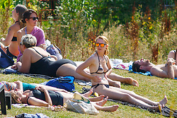 © Licensed to London News Pictures. 17/08/2016. London, UK. People sunbathe and enjoy hot weather at King's Cross Pond Club in London on Wednesday, 17 August 2016. Photo credit: Tolga Akmen/LNP