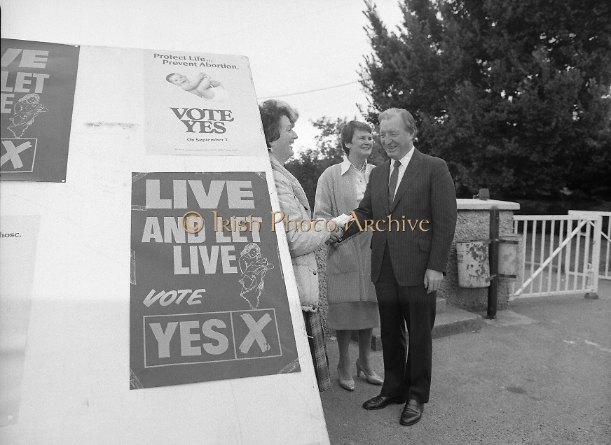 "Charles Haughey Votes in Referendum..1983.07.09.1983.09.07.1983.7th September 1983..Photograph of Mr and Mrs Haughey meeting with ""Yes"" (pro amendment).Campaigner Ms Mary Jones...The referendum was a constitutional amendment with regard to the life of the unborn...  It was a divisive campaign with much debate, charge and countercharge by both sides of the argument..Those in the Yes campaign won the day with a vote of 841,233 to a no vote of 416,136."