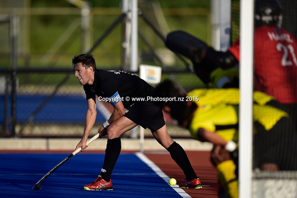 Simon Child (L) captain of the Blacksticks waits to pass out the ball during game three of the Blacksticks Men vs Malaysia hockey match at Blake Park in Tauranga on Wednesday the 9th of March 2016. Copyright Photo by Marty Melville / www.Photosport.nz