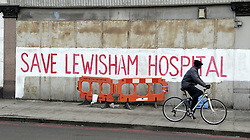 © Licensed to London News Pictures. 17/01/2013.Save Lewisham Hospital has been painted in large red writing on the side of a building in Catford at the junction of Brownhill Road and Plassy Road SE6.  A demonstration march is due to take place at Lewisham Hospital on January 26th against the possible closure of A&E..Photo credit : Grant Falvey/LNP