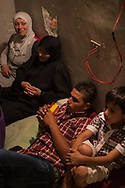 Close friends and family gather at Rafaat's home one last time in Damour, Lebanon on Monday, June 9, 2014.