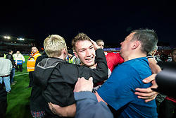 Jack Stacey of Exeter City is mobbed by fans as they invade the pitch at the final whistle - Mandatory by-line: Gary Day/JMP - 18/05/2017 - FOOTBALL - St James Park - Exeter, England - Exeter City v Carlisle United - Sky Bet League Two Play-off Semi-Final 2nd Leg
