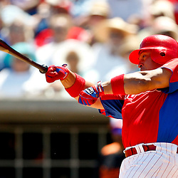 March 25, 2012; Clearwater, FL, USA; Philadelphia Phillies catcher Carlos Ruiz (51) bat flies out of his hand as he takes a swing during the bottom of the second inning of a spring training game against the Baltimore Orioles at Bright House Networks Field. Mandatory Credit: Derick E. Hingle-US PRESSWIRE