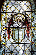 "Stained glass window at St. Katharine Drexel Church in Kaukauna depicts an angel holding a sign that reads ""Blessed are the peacemakers."" (Photo by Sam Lucero)"