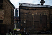 The former Connecting Railroad roundhouse in McKeesport, PA, was built in 1905. Now abandoned, an industrial park developer using federal and state historic preservation agencies is planning to preserve the structure. <br /> <br /> McKeesport has a population of about 20,000 now down from over 55,000 in 1940, with the decrease due to the decline of the steel industry. The major employer was the National Tube Works, a manufacturer of iron pipes, which once employed 10,000 men.<br /> <br /> National Tube closed in the 1980s, following the other U.S. Steel plants in the Mon Valley.<br /> <br /> McKeesport was the site of the first G. C. Murphy five-and-ten-cent store.