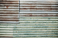 Corrugated metal wall composed to resemble the USA flag, in Antigua, Guatemala on August 13, 2018.