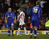 Photo: Paul Thomas.<br /> Stoke City v Millwall. The FA Cup. 05/01/2007.<br /> <br /> Neal Ardley (L) of Millwall has a real go at team-mate Paul Hubertz (30) after Stoke score their second goal.