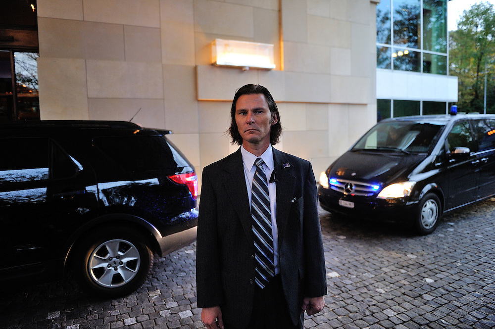 Special Agent of the U.S. DSS (Diplomatic Security Service), part of Secretary of State John Kerry's detail, whilst visiting Geneva for the second round of the E3/EU+3 Iran talks concerning Iran's nuclear program.  E3/EU +3 refers to UK, France and Germany plus U.S., Russia and China.